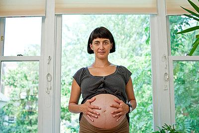 Portrait of pregnant woman - p3722873 by James Godman