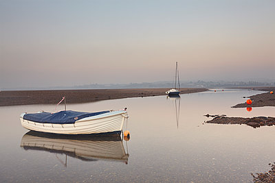 A peaceful calm evening view of the estuary of the River Exe at low tide, Exmouth, Devon, England, United Kingdom - p871m2101283 by Nigel Hicks