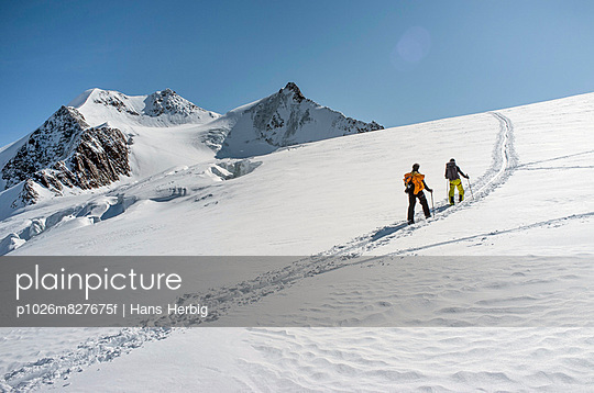 Two people back country skiing, European Alps, Tyrol, Austria