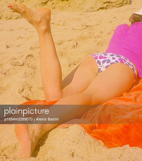 Woman on the beach - p1654m2289070 by Alexis Bastin