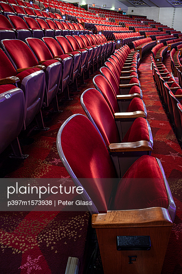 Rows of empty red chairs in a theater - p397m1573938 by Peter Glass