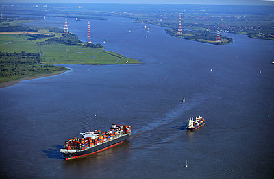 Container ship meets small freighter, Elbe river - p1016m2211976 by Jochen Knobloch