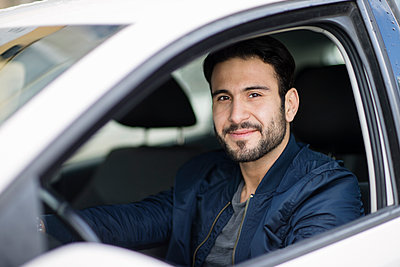 Smiling man in car - p312m1187831 by Susanne Walstrom