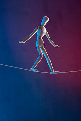 An artist's figure walking a tightrope - p301m730766f by Larry Washburn