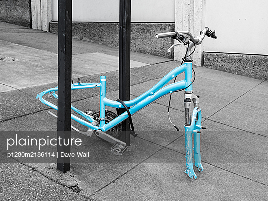 Bicycle with stolen wheels - p1280m2186114 by Dave Wall