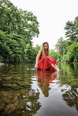 Girl In Red Dress in Stream - p1019m2100437 by Stephen Carroll
