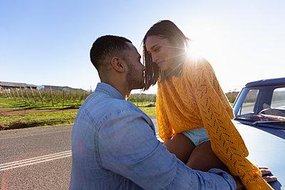 Young couple on a road trip taking a roadside break - p1315m2130607 by Wavebreak