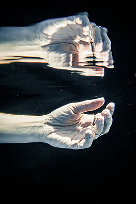 Hands underwater - p1019m1461907 by Stephen Carroll
