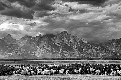 Clouds over mountains in rural landscape - p1023m769070f by David Henderson
