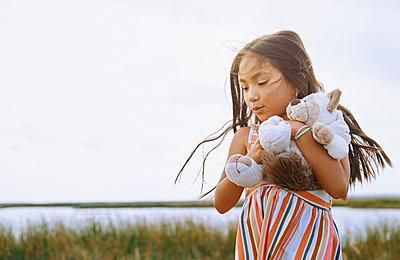 Cute girl holding stuffed toy animal - p300m2273733 by Arman Zhenikeyev
