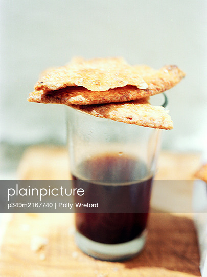 Espresso glass and biscuits, Spain - p349m2167740 by Polly Wreford
