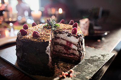 Close-up of sliced Christmas cake on table - p1166m1087913f by Lumina Images
