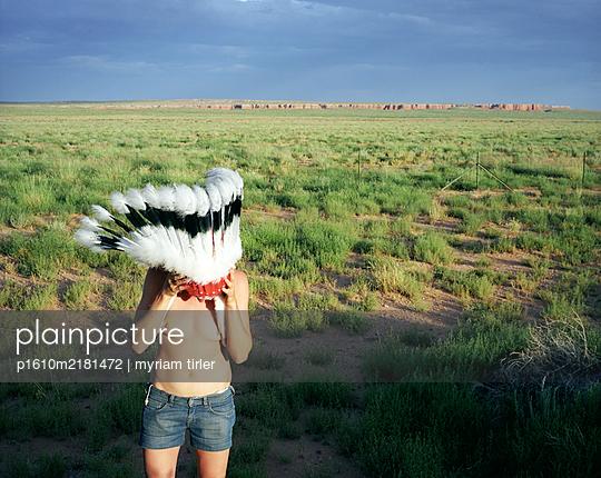 Girl wearing an indian headwear - p1610m2181472 by myriam tirler