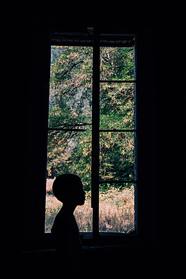 Child in Window - p1262m1063970 by Maryanne Gobble