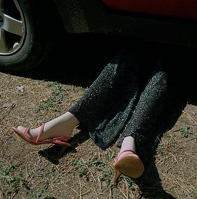 Female Mannequin Laying Under Car - p694m1192947 by Nancy Grace Horton