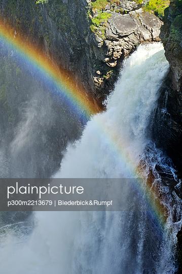 Sweden, Gaeddede, Rainbow at waterfall Haellingsafallet - p300m2213679 by Biederbick&Rumpf