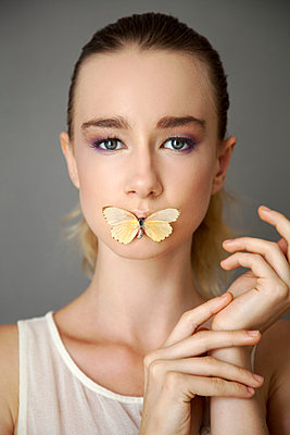 Woman with Butterfly Lips - p1248m1045153 by miguel sobreira