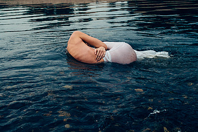 Woman Laying in Water - p1262m1168932 by Maryanne Gobble