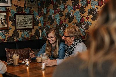Women having coffee in cafe - p312m2191308 by Jennifer Nilsson
