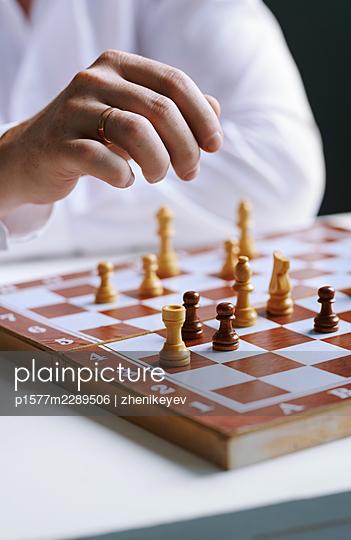 Man playing chess - p1577m2289506 by zhenikeyev