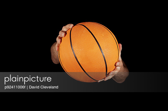 Close up of basket ball being held