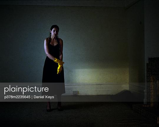 Woman in dark room - p378m2235645 by Daniel Keys