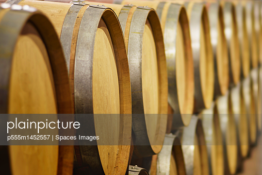 Close up of wine barrels in cellar - p555m1452557 by Spaces Images
