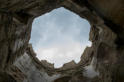 The view up the tower of a historic castle which is missing its roof - p1433m2132700 by Wolf Kettler