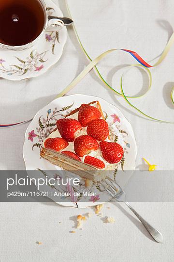 Slice of birthday cake with tea - p429m711672f by Anouk de Maar
