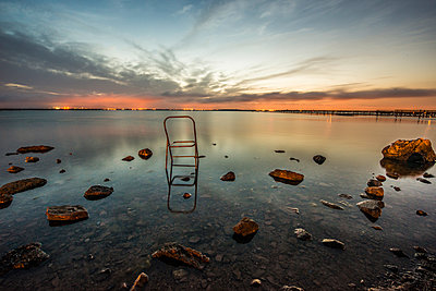 Broken chair on the waterfront - p829m1110846 by Régis Domergue