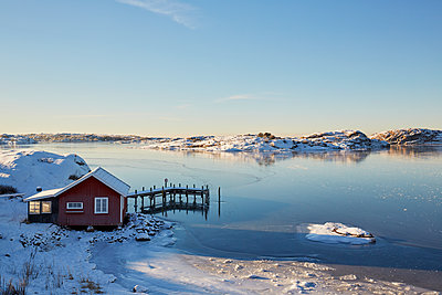 Winter landscape with lake and boat house - p312m1470349 by Jan Tove