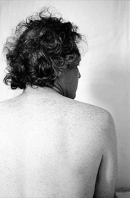 Rear view, Bare-chested man - p1648m2244739 by KOLETZKI