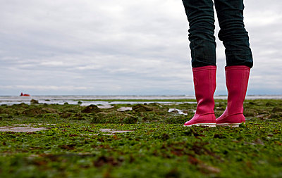 Woman in pink rubber boots - p7180009 by Arne Landwehr