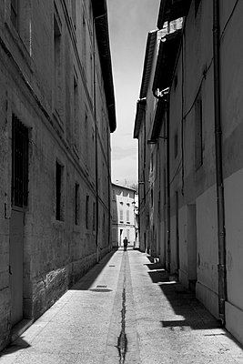 Narrow street in the city center of Avignon - p813m934074 by B.Jaubert