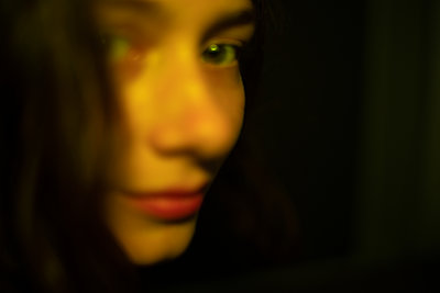 Face of young woman, blurred view - p1321m2231542 by Gordon Spooner