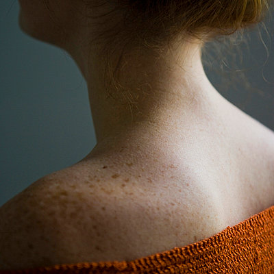 Woman with freckles - p4263726f by Tuomas Marttila
