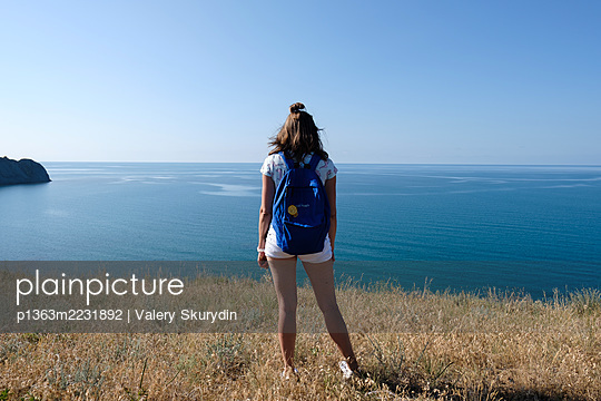Woman on cliff - p1363m2231892 by Valery Skurydin