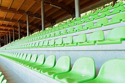 Row of seats in sport stadium - p300m1166338 by Francesco Morandini