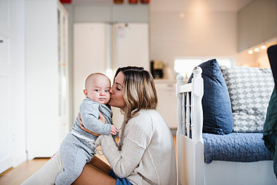 Mother kissing baby son - p312m2051292 by Anna Johnsson
