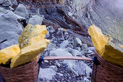 Sulphur miner at the Kawah Ijen Sulphur Mines in East Java - p934m1022324 by Dominic Blewett