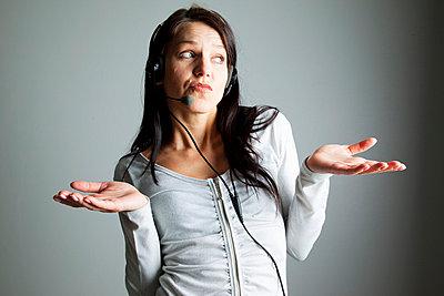 Woman with head set - p4130547 by Tuomas Marttila