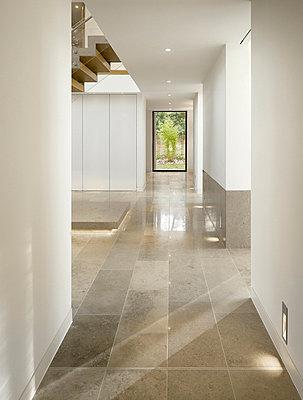 Access corridor in show home, Highfield, Prestbury, Cheshire, UK. - p855m664504 by Daniel Hopkinson