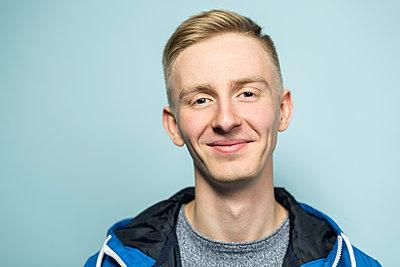 Portrait of smiling young man - p300m2043174 by Vladimir Godnik
