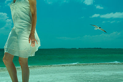 Woman walking on beach - p6750701 by Matthieu Spohn