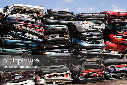 Stacks of crushed cars - p9243810f by Image Source