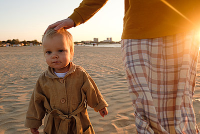Mother and son on beach - p1363m2142787 by Valery Skurydin