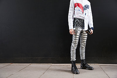 Man in metallic striped trousers and white shirt, horizontal - p1407m1545365 by Guerrilla