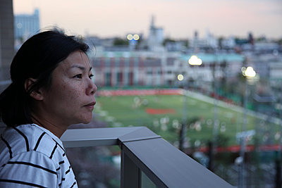 Woman on balcony - p664m1132601 by Yom Lam