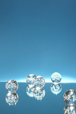 Crystal balls against blue background - p237m1461362 by Thordis Rüggeberg