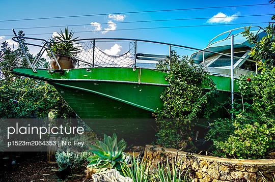 Mediterranean garden with motorboat deco - p1523m2064353 by Nic Fey